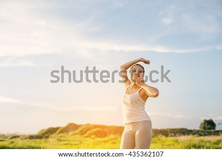 Beautiful young yoga women stretch her hand and yawning in the morning.with sunrise