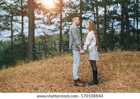 Beautiful youth and stylish couple posing outdoor