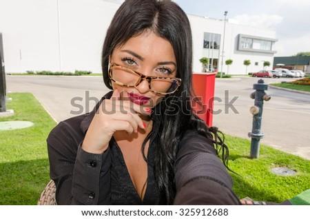 beautifull business woman photographing selfie - stock photo