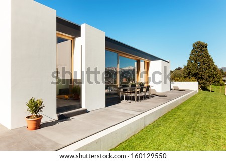 Beautifull modern house in cement, interiors, view from the corridor