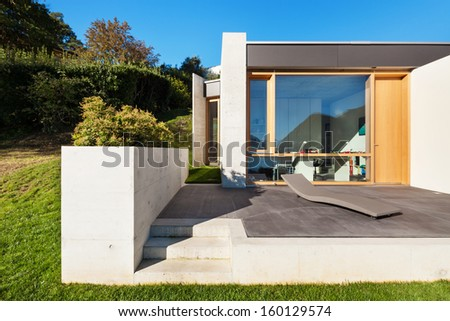 Beautifull modern house in cement, interiors, view from the corridor - stock photo