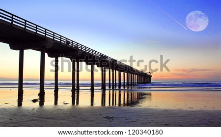 Beautifull Sunset with full moon at Pacific Ocean - stock photo