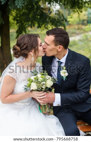 Beautifull wedding couple kissing and embracing outdoor. One beautiful wedding day