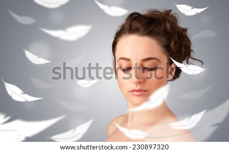 Beautifull young girl with light feather skin concept on gradient background - stock photo