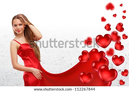 Beautifull young woman in evening dress and heart symbols around - stock photo