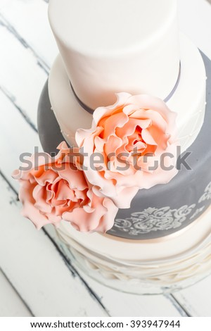 beautifully decorated cake with pink roses - stock photo