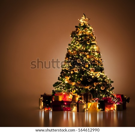 Beautifully decorated Christmas tree with many presents under it. - stock photo