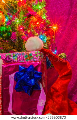 Beautifully decorated Christmas tree with many presents under it