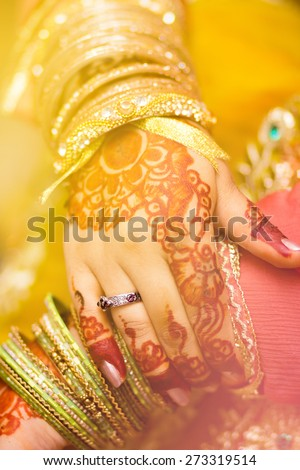 beautifully decorated hands of an Indian bride with henna - stock photo