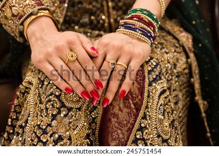 beautifully decorated Indian bride hands - stock photo