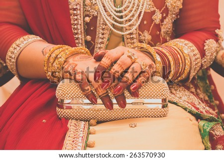 beautifully decorated Indian bride hands. - stock photo