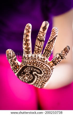 beautifully decorated indian hands with mehandi - stock photo
