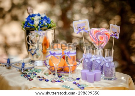 beautifully decorated peach and lilac summer wedding table - stock photo