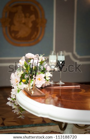 beautifully decorated wedding glasses with champaign - stock photo