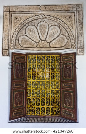 Beautifully decorated window in Bahia palace in Marrakech, Morocco