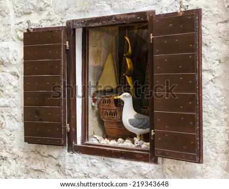 Beautifully framed ancient window, Mediterranean, Budva, Montenegro - stock photo