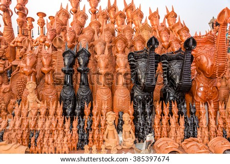 Beautifully hand crafted clay horses, elephants and other toy puppets made in the town of Bankura, West Bengal, India. - stock photo