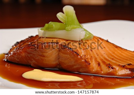Beautifully plated salmon fillet. - stock photo