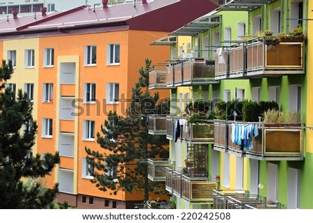 Beautifully renovated old classic tower block in modern colorful building with balconies. Prefab - City Brno, Czech Republic, Europe - stock photo