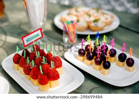 beautifully served strawberry and grapes wedding appetizers - stock photo
