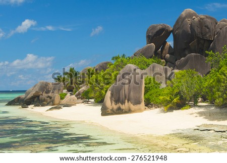 Beautifully shaped granite boulders and a perfect white sand at the famous Anse Source d'Argent beach, La Digue island, Seychelles - stock photo