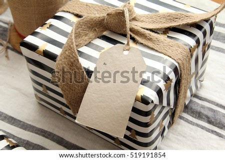 Beautifully wrapped Christmas present, with blank card. Add your own text.