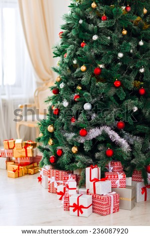 beautifully wrapped gifts under the christmas tree - stock photo