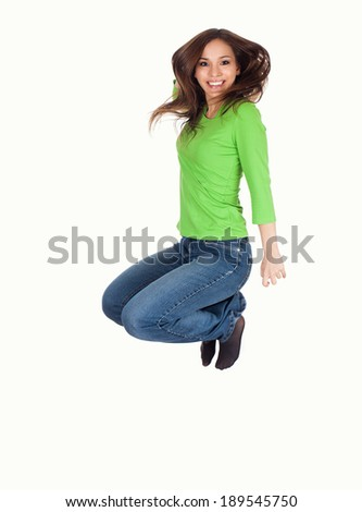 beautifyl wonab jumping with joy, white background - stock photo