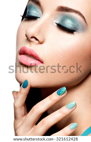 Beautiul fashion woman with turquoise make-up and nails  - on white background - stock photo