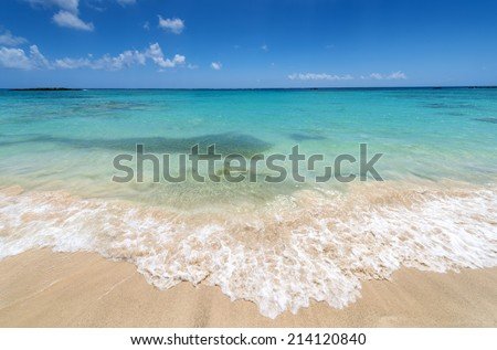 Beautiul Sandy Beach  With Turqoise Se Water And Blue Sky