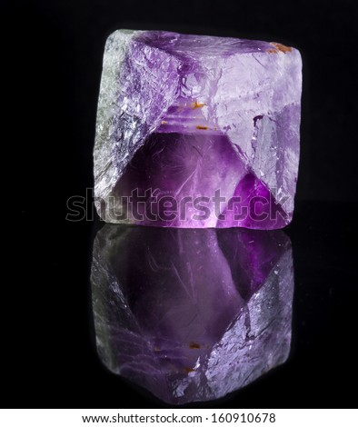 Beautuful Big Fluorite Crystal Purple with reflection on black surface background
