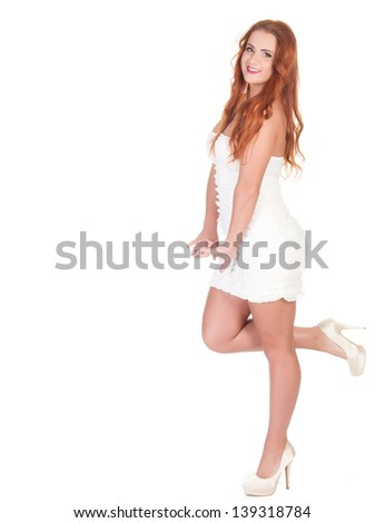 Beautuful woman with red long hair posing in white dress. isolated on white