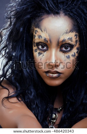 beauty afro girl with cat make up, creative leopard print closeup halloween woman