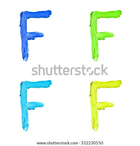 """Beauty alphabet set - blue, green and yellow dye letters isolated on white background. """"F"""" letter. - stock photo"""