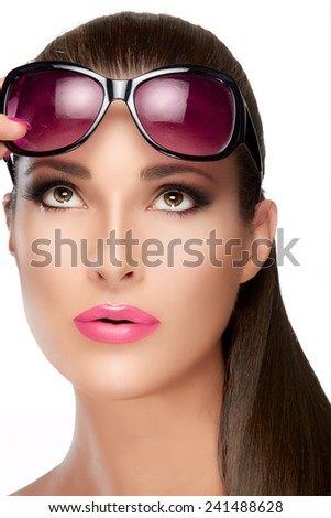 Beauty and Fashion Concept - Close up Pretty Young Woman with Long Straight Hair Wearing Stylish Red Violet Shades on Forehead, Looking up. High fashion portrait Isolated on White Background. - stock photo
