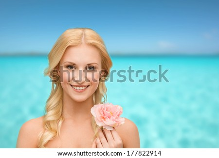 beauty and floral concept - bright picture of smiling woman with peony flower - stock photo