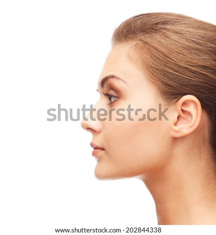beauty and health concept - profile portrait of young woman