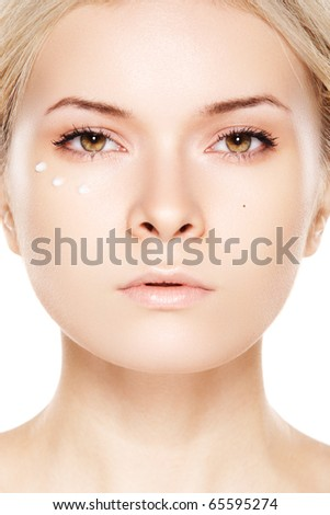 Beauty and healthcare, make-up & cosmetic. Skincare. Light close-up portrait of beautiful woman with daily cream on white backgroun.