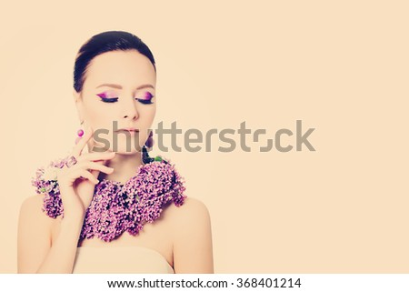 Beauty and Makeup. Beautiful Woman on Background with Copy Space - stock photo