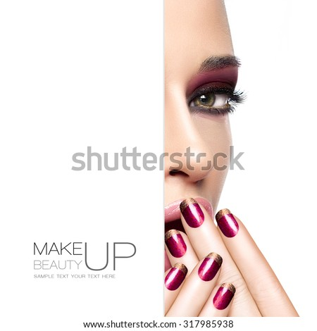 Beauty and makeup concept with a half face portrait of a gorgeous woman with fashion make-up and nails. Blank copy space alongside with sample text. Template design - stock photo