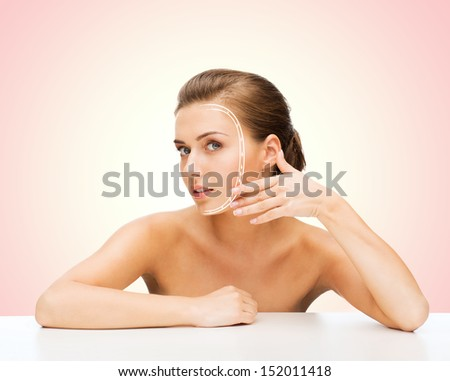 beauty and skin care concept - face of beautiful woman with lines - stock photo