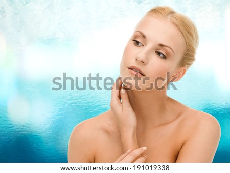 beauty and spa concept - face of beautiful woman touching her face skin - stock photo