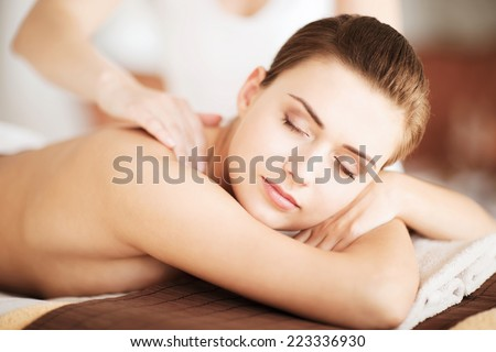 beauty and spa concept - woman in spa salon getting massage - stock photo