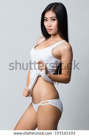 Beauty asian woman wearing white shirt and white lingerie