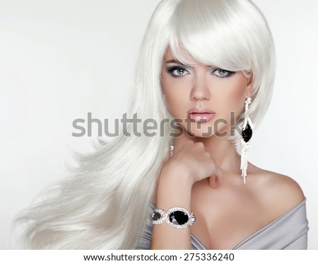 Beauty attractive blond portrait. White Long hair. Fashion girl model posing with Expensive Jewelry. - stock photo