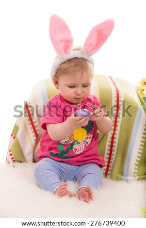 Beauty  baby girl with bunny ears holding Easter egg - stock photo