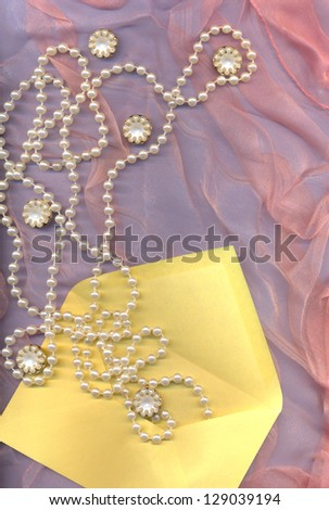 beauty background with button and pearl - stock photo