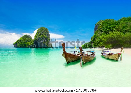 Beauty beach and limestone rocks, focus on the boats - stock photo