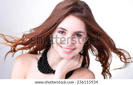 Beauty.Beautiful Girl with dark brown hair . Long straight hair Shine with health.