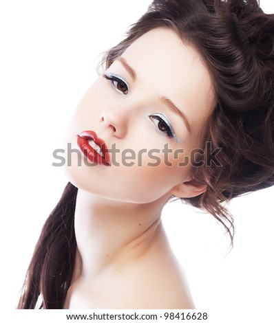 Beauty. Beautiful woman face with chic red lips close up. Bright makeup and hairstyle - stock photo